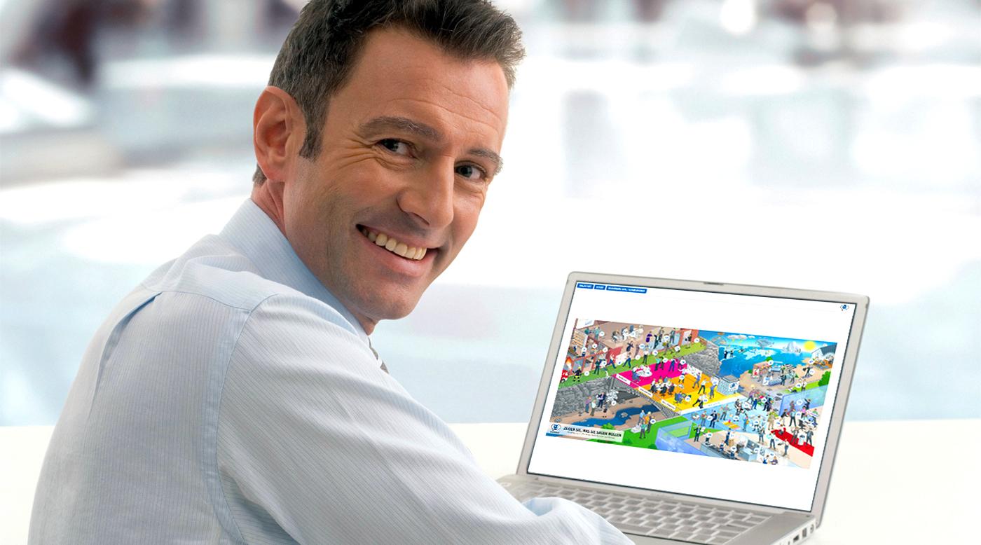 Lächelnder Mann im Hemd am Laptop